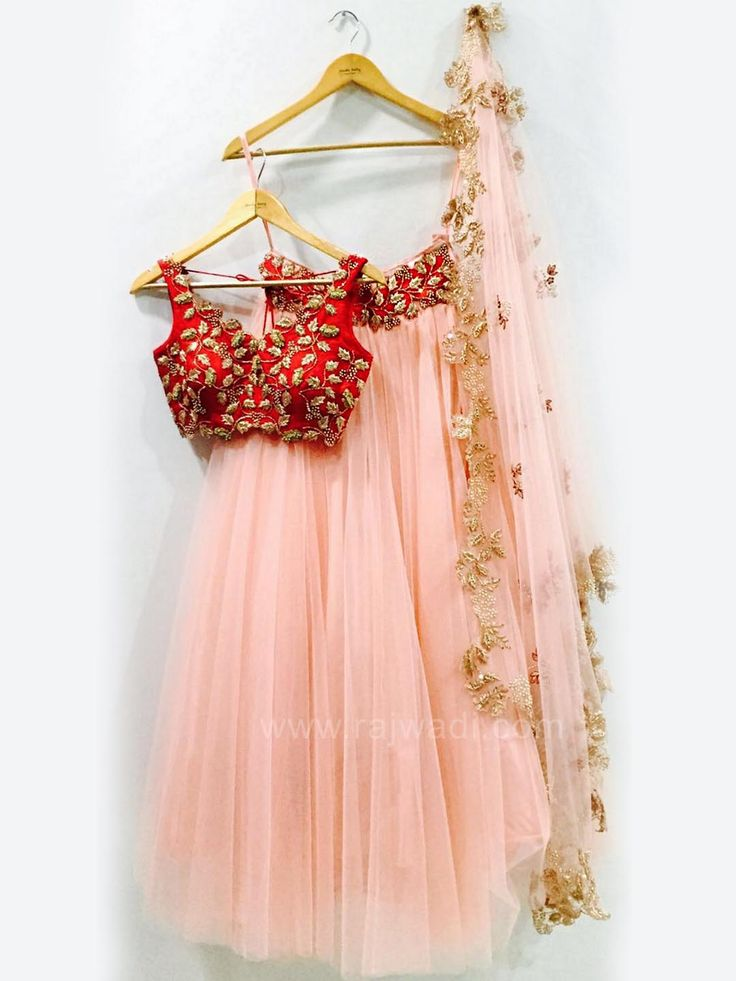 Vibrant Pink Net fabric flared Lehenga is teamed with pure Raw Silk contrast Red Choli and Net Pink dupatta with designer border. This Lehenga Choli is designed with zardozi work will create an individual look.