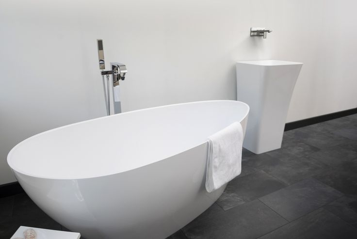 Modena Freestanding Bathtub | Only available while stock lasts Decide now for a real stone cast bathtub at a discounted price. Original stone cast designer bathtubs produced in ... view details on www.treniq.com