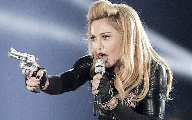 Madonna performing on her MDNA Tour.Neil McCormick reviews US pop star Madonna's concert at Hyde Park, part of her MDNA Tour.