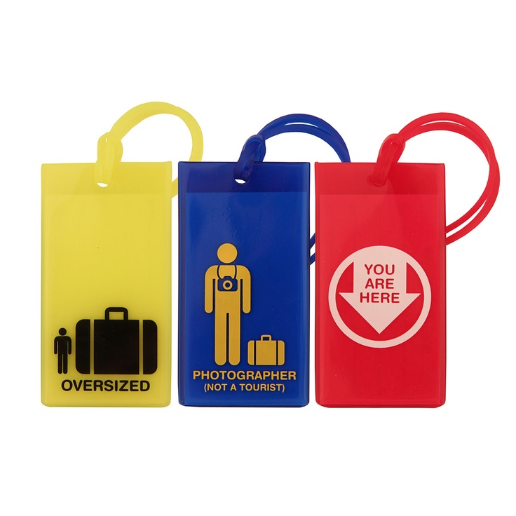"""""""I just need the *oversized* :-D  LOL"""" -- Icon Luggage Tags Set Of 3 by FLIGHT 001 - You're heading off on your annual getaway to Costa Rica. Don't suffer a luggage loss like last year's. This assortment of Icon Luggage Tags in yellow, blue, and red, will make you a stylish, organized nomad. Each transparent tag has an identification card inside, and is printed will a clever graphic that will get a smile out of fellow travelers."""