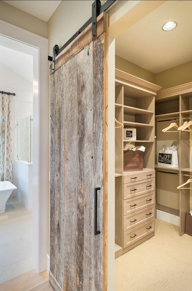 Closet. Walk-in Closet Ideas. Beautiful sliding barn doors made of reclaimed barn wood. #Closet