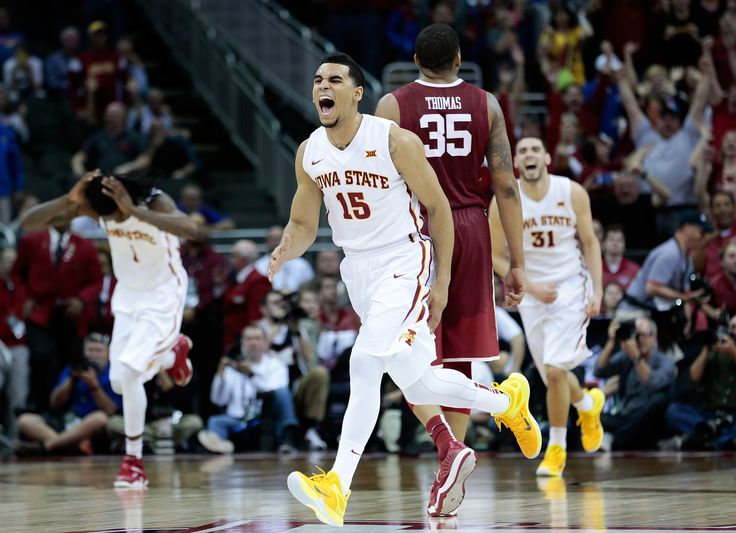 Iowa State guard Naz Long (15) and the rest of the Iowa State basketball team react after time expired with them defeating Oklahoma 67-65 during their Big 12 Tournament semifinal game on March 13, 2015 at the Sprint Center in Kansas City, MO. Photo by Brian Achenbach/Special to the Ames Tribune.