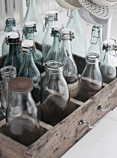 makes a great decor item...... put some flowers in the bottles without lids, maybe some old colorful marbles in the ones with lids.