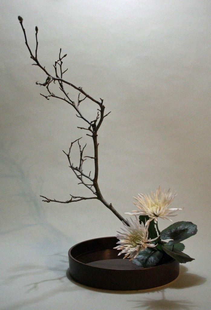 Moribana with white chrysanthemum and tulip magnolia