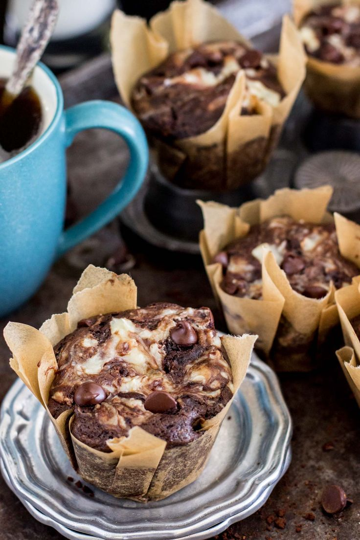 Rich double chocolate muffins with swirls of cheesecake.      Mondays are for muffins.