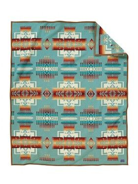 Chief Joseph Blanket  First made in the 1920s, the Chief Joseph blanket is one of the oldest, on-going blankets made by Pendleton Woolen Mills. The blanket pattern celebrates the heroism of the Northwest's great Nez Perce leader, Chief Joseph. Its design is balanced with arrowheads symbolizing bravery and pointing in all directions of Mother Earth. The Chief Joseph is a woven jacquard that is reversible to offer two dramatically different looks.