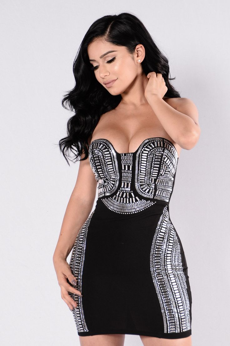 Available in Black Strapless Mini Dress Silver Rhinestone Detail Zipper Back Padded Cups 96% Polyester 4% Spandex