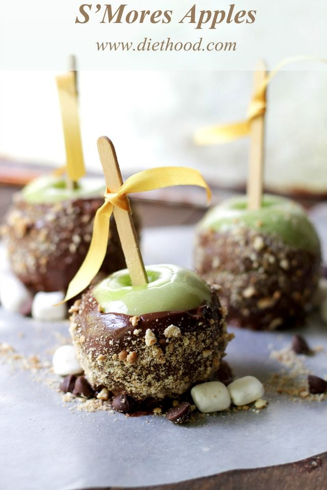 S'Mores Apples | www.diethood.com | Beautiful green apples dipped in melted marshmallows, then chocolate, and finished off with a sprinkle of ground graham crackers. | #smores #apples #taffyapples #recipe