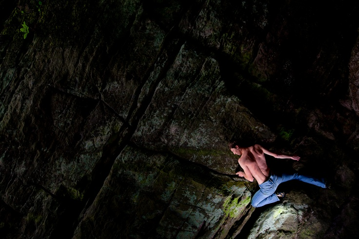 Davide Fracasso, a skilled and motivated climber from Italy, captured in an intriguing pose on his new bouldering project deep in the forests of Ibbenburen, Germany.