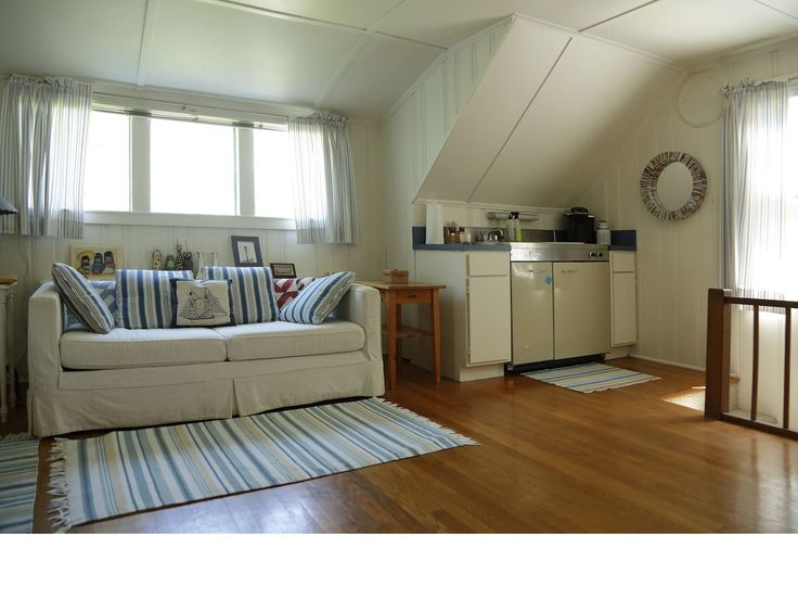 Kitchenette with stove and refrigerator. Full size pull out sofa bed