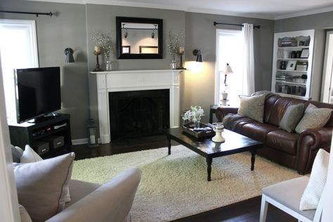 Furniture. Warm Living Room Design With Black Iron Frame Fireplace And Brown Leather Sofa And Black Stained Wooden TV STand. Awesome Small Brown Leather Couch For Your Lovely Living Room #familyroomdesignwithtv