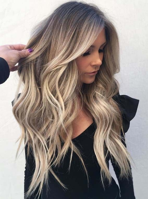Wanna wear sun-kissed shades hair color? See here we have made a collection of sensational blonde balayage hair colors that you may use to wear for amazing highlights of sun-kissed hair colors right now. These are awesome shades of balayage hair colors in year 2018.