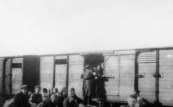 Jews boarding a transport, Lublin, Poland.