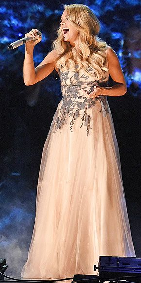 """To perform """"Something in the Water,"""" Carrie's back to a look she loves: A flowy, ethereal greige gown embroidered with floral appliqués on the bodice."""