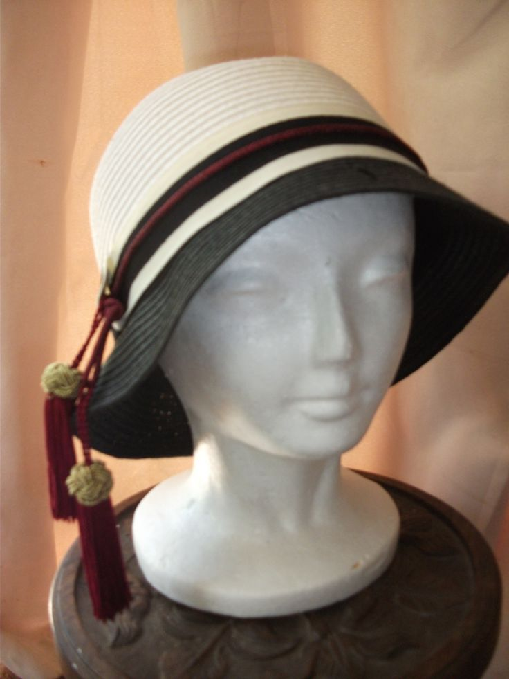 Modern 2-toned straw 'Art Deco' hat with added tassels.