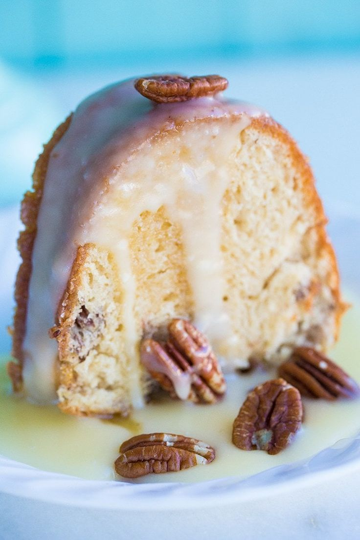 Pecan Butter Rum Cake Recipe -fast, easy and THE most delicious cake you'll bake this year! Buttered rum glaze is drizzled on a butter pecan cake - amazing!