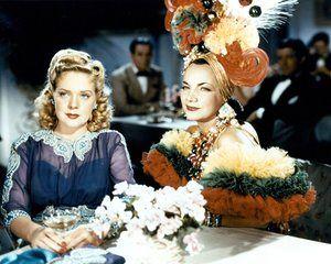 Carmen Miranda (right) sitting next to Alice Faye in a scene from 1941 film Week-End In Havana.