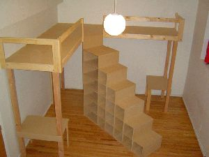 These loft beds are GENIUS!  Talk about space-saving!  2 beds, 2 desks and WAY more storage than 2 dressers.  Secure a railing on those steps and it's the perfect dorm setup!