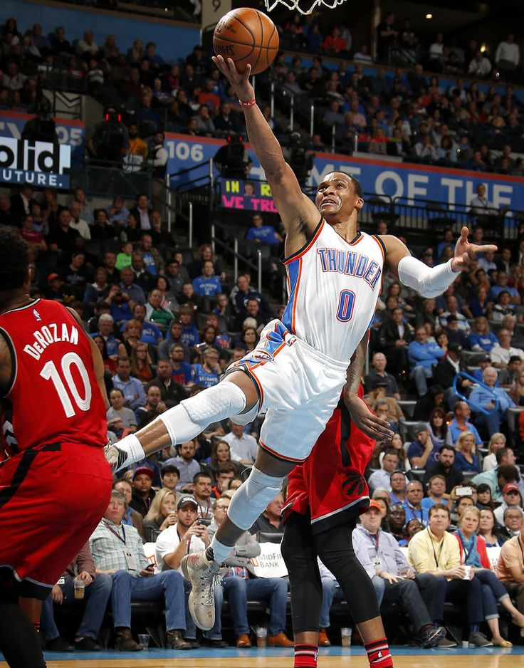 Oklahoma City's Russell Westbrook (0) goes to the basket beside Toronto's DeMar DeRozan (10) during an NBA basketball game between the Oklahoma City Thunder and the Toronto Raptors at Chesapeake Energy Arena in Oklahoma City, Wednesday, Nov. 9, 2016.  Photo by Bryan Terry, The Oklahoman