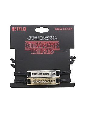 """Cord bracelet set from the Netflix Original series, <i>Stranger Things</i>, featuring burnished gold & silver tone engraved plates that read """"Friends Don't Lie"""" - with """"011"""" on the metal adjusters. <br><ul><li style=""""list-style-position: inside !important; list-style-type: disc !important"""">Adjustable</li><li style=""""list-style-position: inside !important; list-style-type: disc !important"""">Alloy; man-made materials</li><li style=""""list-style-position: inside !important; list-style-type: disc !i"""