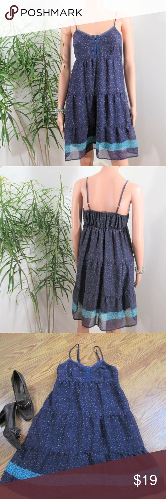 """Mossimo* Navy Floral Baby Doll Mini Dress Navy blue chiffon with tiny purple/gold/turquoise flowers. Contrasting stripe near hem Tiered skirt, empire waist. Solid lining. Hook & eye bodice closure. Adjustable straps, elastic across back.  Measured flat. 14"""" pit to pit. 28"""" long with out straps. Mid thigh on 5' 9'' model, 33'' x 24'' x 33.5''. poly Mossimo Supply Co. Dresses Mini"""