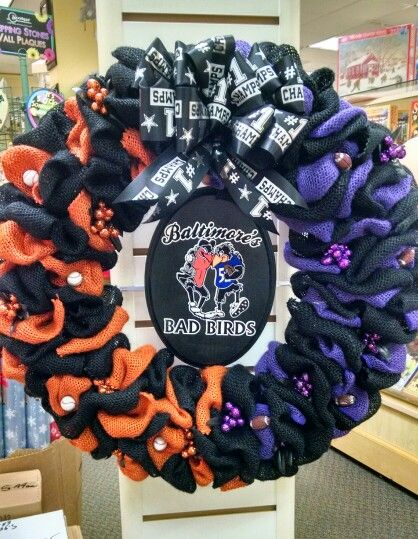 Custom made Wreath #6: my  CUSTOM MADE Baltimore's Bad Birds Wreath....I made this for one of my ladies at work who is the ultimate Baltimore Orioles and Baltimore Ravens fan!!!