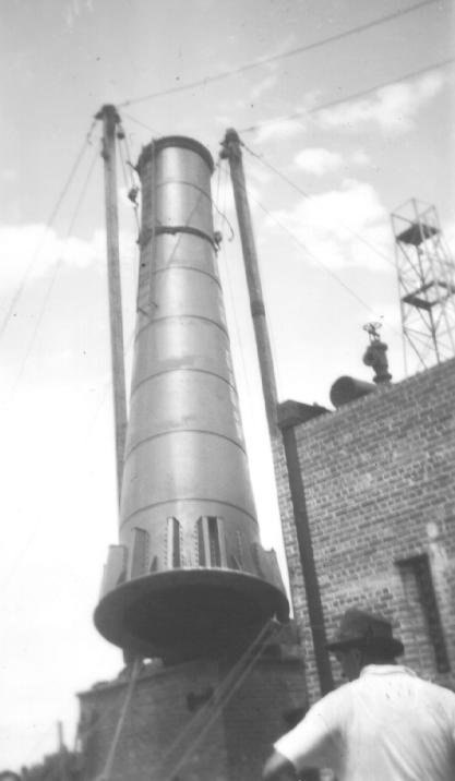Dismantling of an industrial chimney at the Jam Factory, 1950.