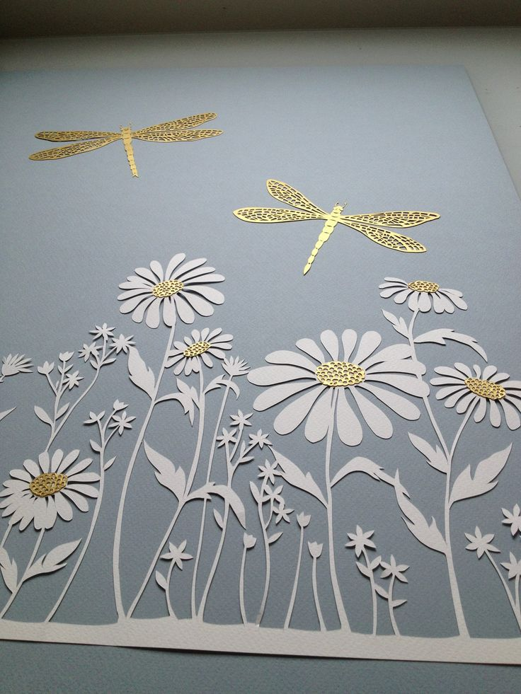 Detail of a papercut commission with daisies and gold dragonflies