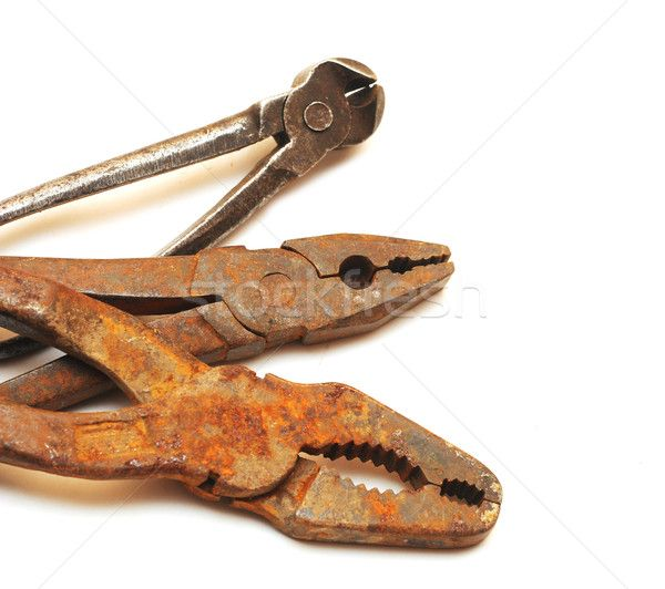 963335_stock-photo-old-rusty-pliers-on-a-plain-white-background.jpg (600×532)