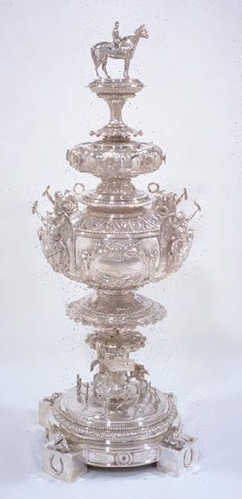 The Preakness, Woodlawn Vase by Tiffany.  34 inches tall, 29 pounds, 12 ounces (The actual trophy is held by the Maryland Historical Society and is valued at over 4 million dollars.)