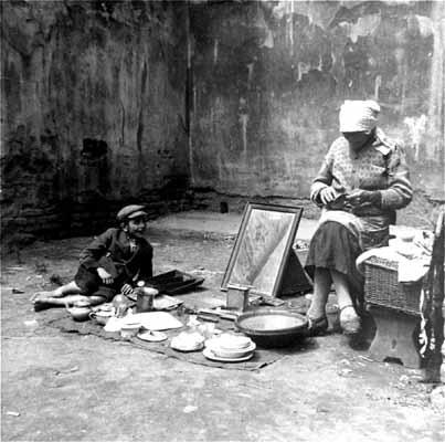 Boy with mother in ghetto- Przemysl