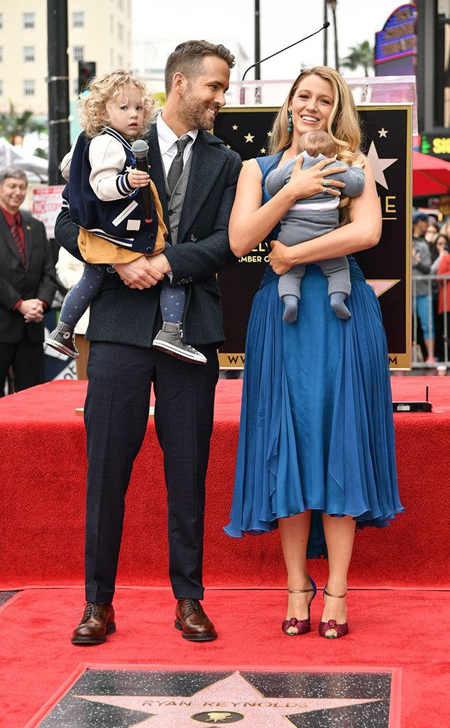 The Deadpool star held the infant in his arms as their older daughter James was preoccupied with a microphone