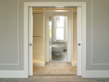 The perfect layout, doors into dressing room with ensuite bathroom beyond, so no noise in the bedroom!