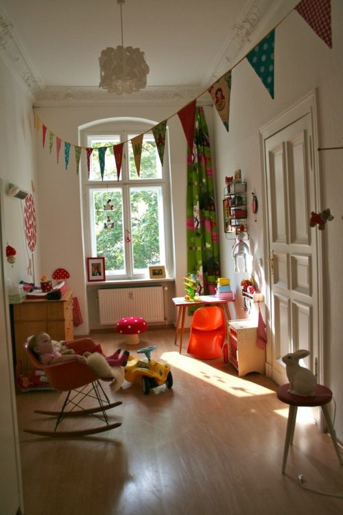Kids room with bright colors, Eames rocker and banners
