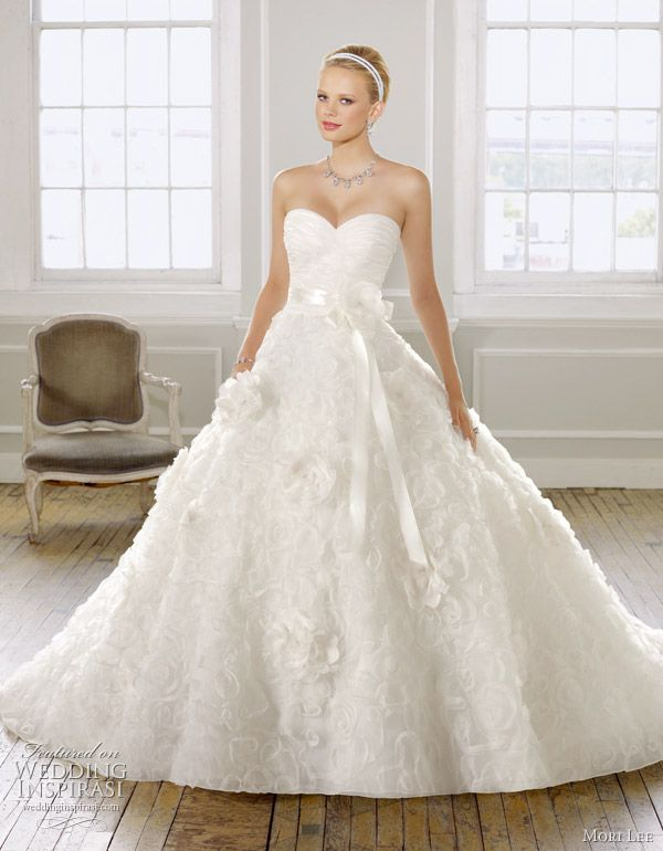 Mori Lee wedding gown Spring/Summer 2011 - Organza with floral design. Ribbon waist sash with flower.