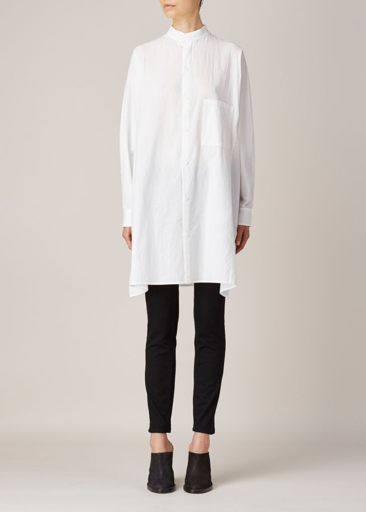 Long button up shirt in white cotton. Oversized sleeves. Mandarin collar. Side slits and single patch pocket at chest. Machine wash cold medium iron and dry clean.