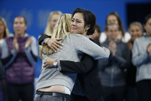 Chinese tennis player Li Na, right, and Petra Kvitova of the Czech Republic embrace each other during a special retirement ceremony for her during the China Open tennis tournament at the National Tennis Stadium in Beijing, China, Tuesday, Sept. 30, 2014. (AP)
