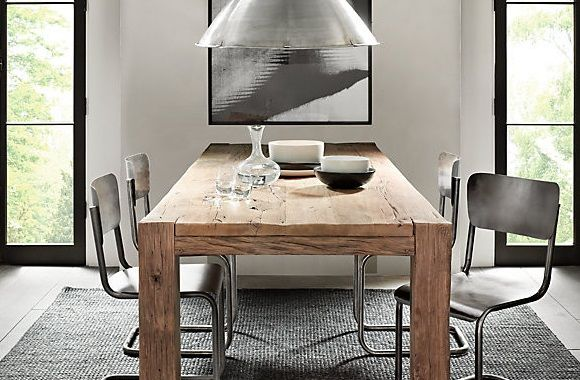 rustic dining table paired with modern chairs lighting more