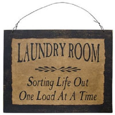 """Our primitive signs feature friendly reminders, inspirational quotes, and humorous messages stenciled on a tea-dyed background and set on a distressed black wooden board. Laundry Room design reads: """"L"""