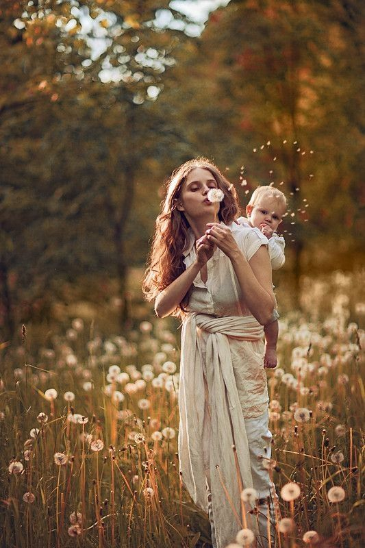 Please, does anyone know the source of this beautiful babywearing photo?