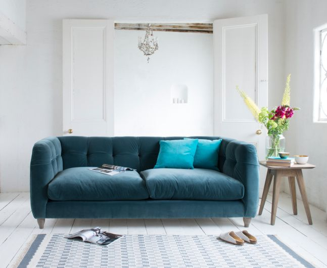 """""""Happy?"""" we were asked when this sofa first came to life. """"Not quite,"""" we replied. But a tiny tweak later to give the fabric a slightly looser, more relaxed feel, we definitely were. Bring on the happy!"""
