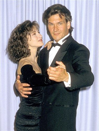 Image: 1988: Actors Patrick Swayze and Jennifer Grey attend the 60th Annual Academy Awards at the Shrine Auditorium on April 11, 1988, in Lo...