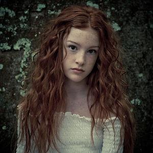 pale skin dark brown eyes long red hair humans