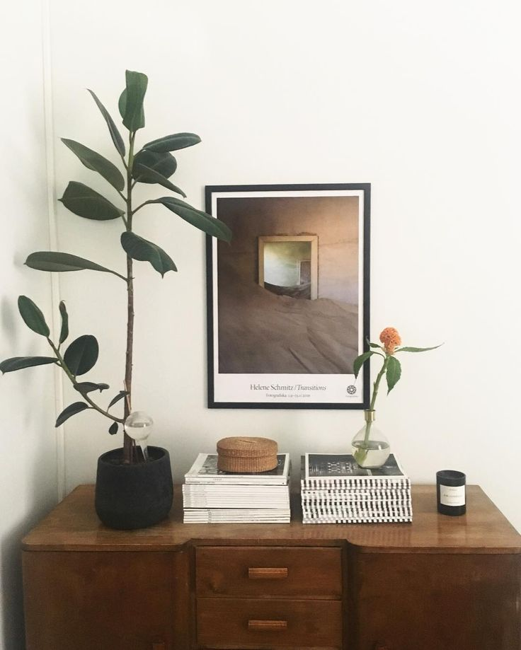 gorgeous dresser top styling- plant, art, stacks of books