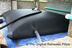 The 3,600 custom Original Rainwater Pillow is installed under a deck. The Pillow is attached to the home's landscape irrigation system and the water collected will be used to irrigate the landscape. Water is collected from the home's roof as well as the pervious paver driveway.  www.rainwaterpillow.com