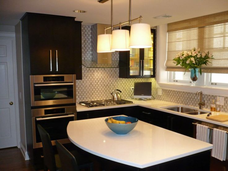 flat panel dark cabinet stainless steel appliance floating cabinet glass hood patterned wall white countertop celing lamps recessed lights of Renovating Your Condo Kitchen with These Stunning Designs