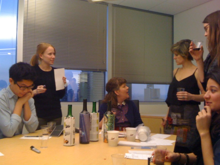 The staff, working very, very hard at RachaelRayMag: April 2012 Word Of Mouth: Cheap Wine Taste Test In Progress