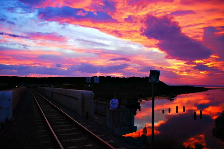 A sunrise scene at the train bridge at Hartenbos, South Africa.