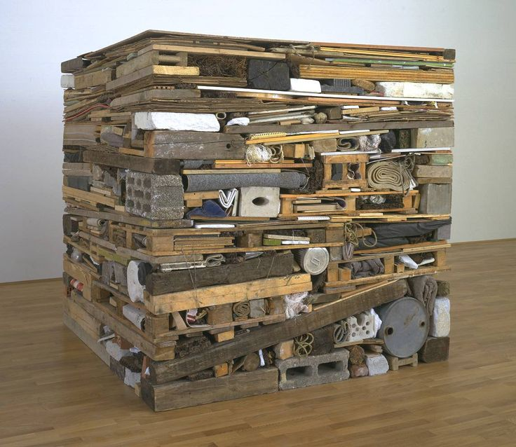 Stack, Tony Cragg. Stack consists of a multitude of miscellaneous objects and materials packed tightly together to form a solid cube.  Insisting that what we call the 'natural world' is increasingly man-made, Cragg has said that he 'refuse[s] to distinguish between the landscape and the city',