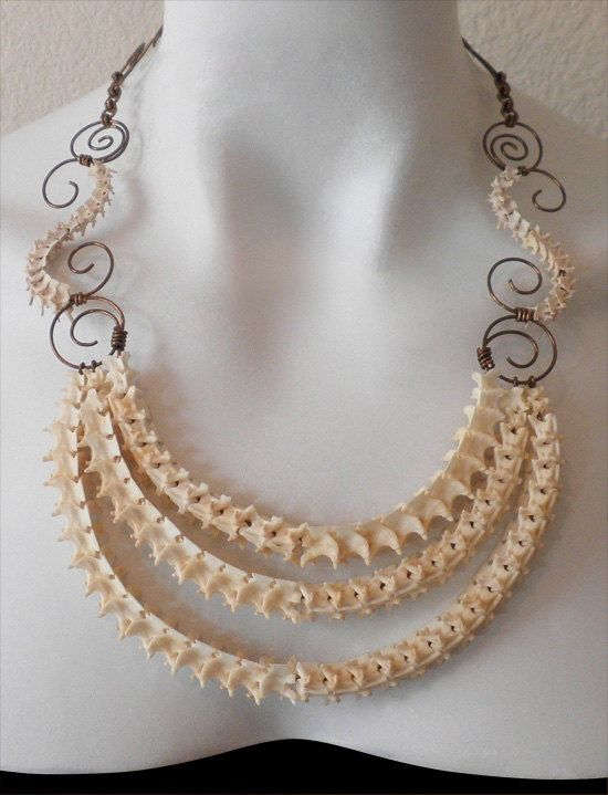 snake vertebrae necklace by kirstin bunyard.  Different but cool.